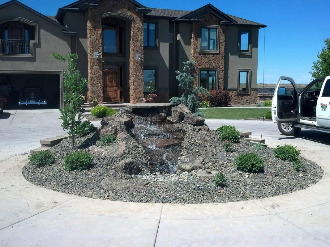 landscaped fountain house in jerome